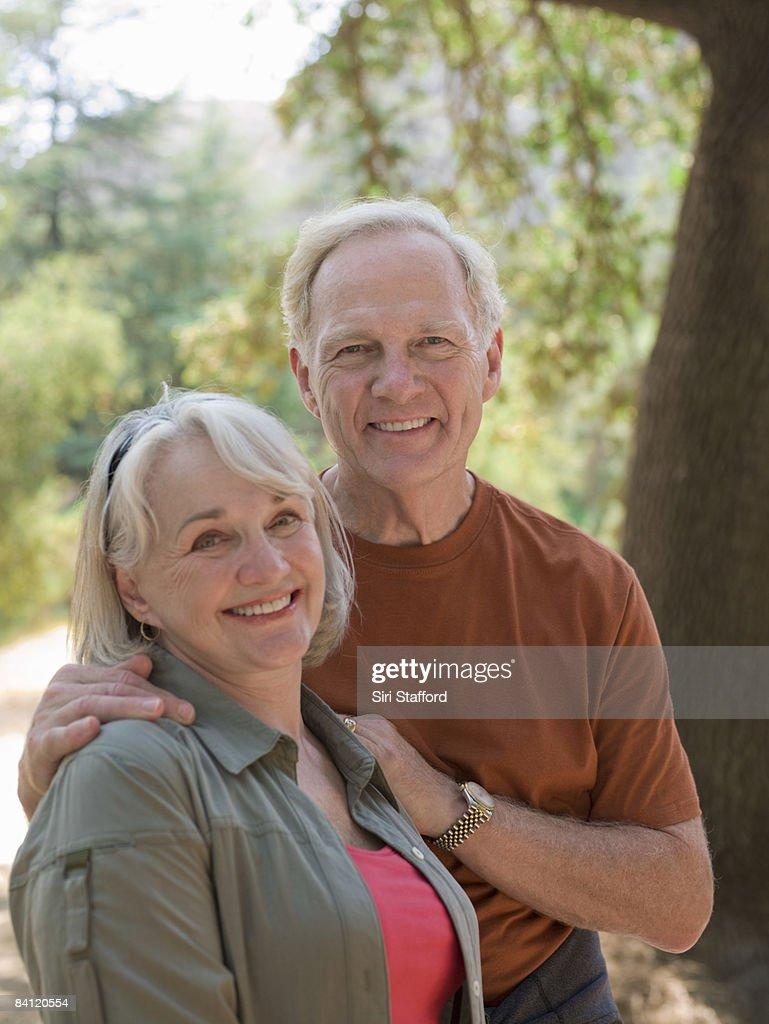 Portrait of mature couple in nature.