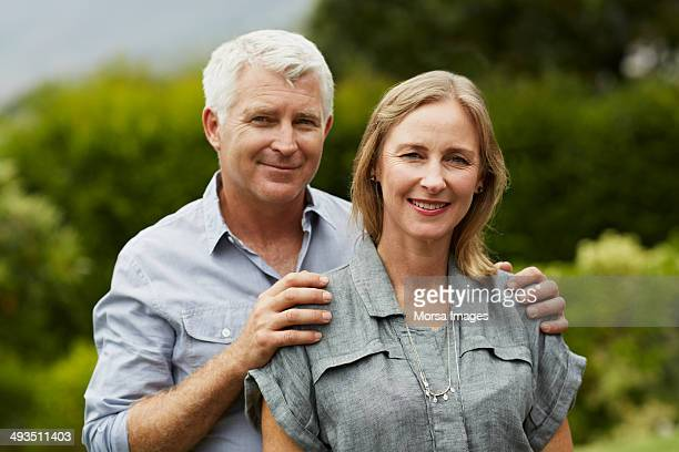 Portrait of mature couple in park