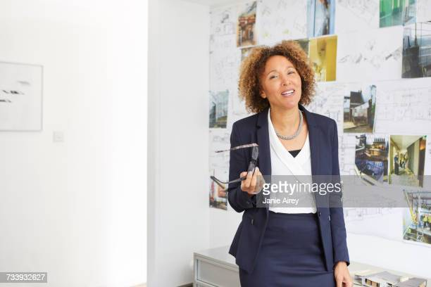 Portrait of mature female architect in office
