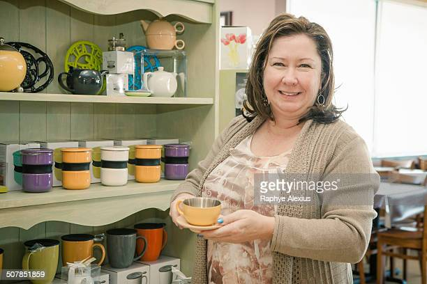 Portrait of mature female business owner in cafe