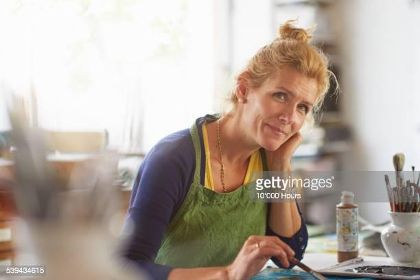 Portrait of mature female designer in her studio