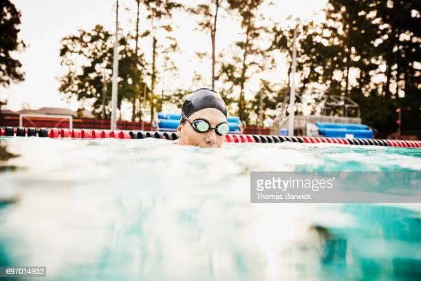 Portrait of mature female swimmer during early morning workout in outdoor pool