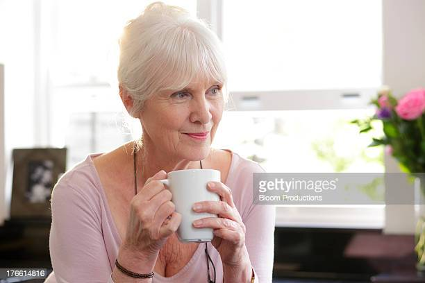 Portrait of mature lady holding a mug of tea
