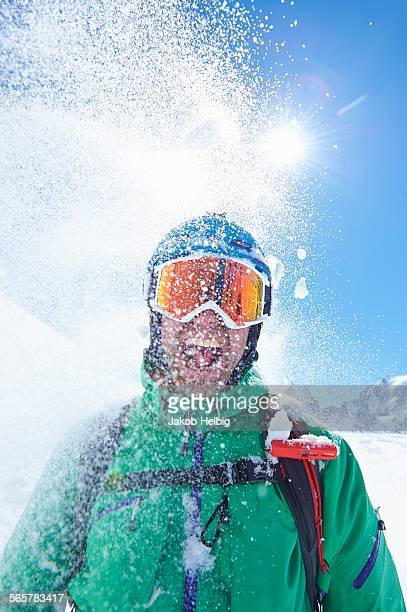 Portrait of mature male skier covered in powder snow, Mont Blanc massif, Graian Alps, France