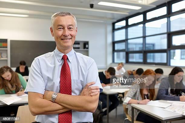 Portrait of mature male teacher in classroom