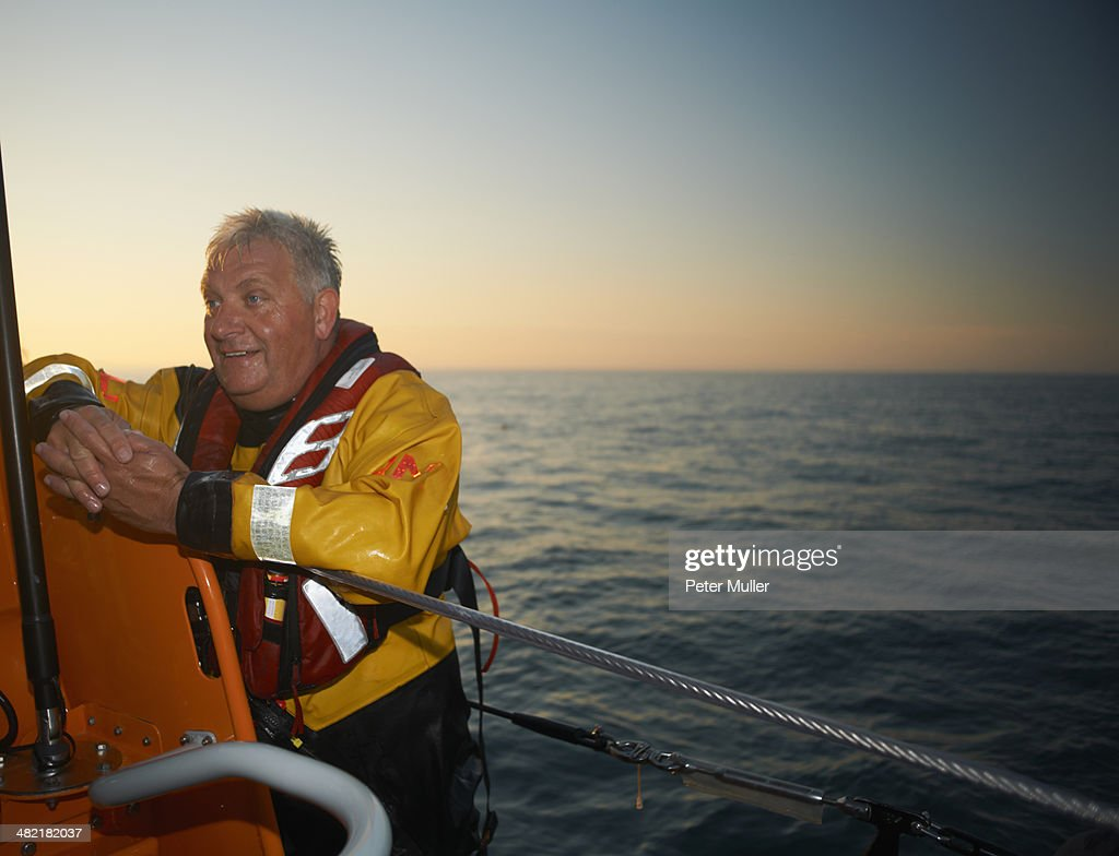 Portrait of mature man crewing lifeboat at sea