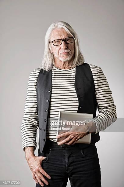 Portrait of mature man, holding digital tablet