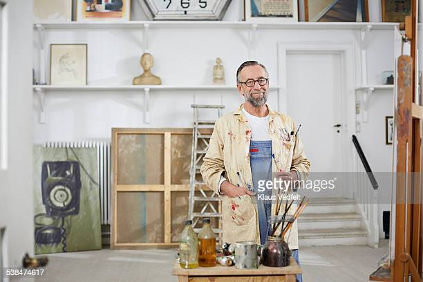 Portrait of mature man in his home art studio
