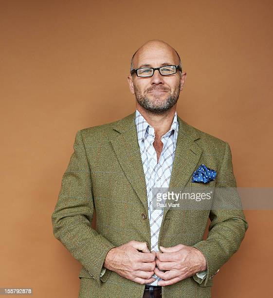 portrait of mature man in tweed jacket
