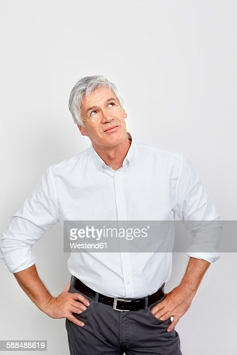 Portrait of mature man looking up in thought