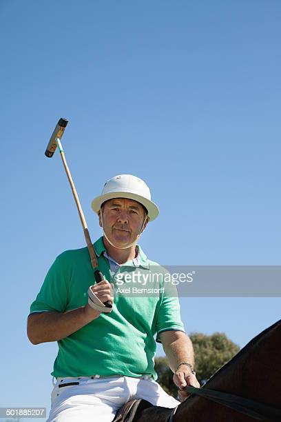 Portrait of mature man playing polo