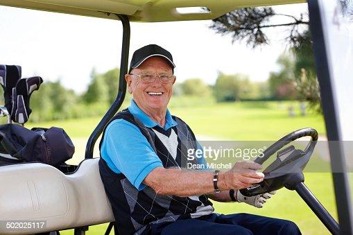 Portrait of mature man sitting in a golf cart