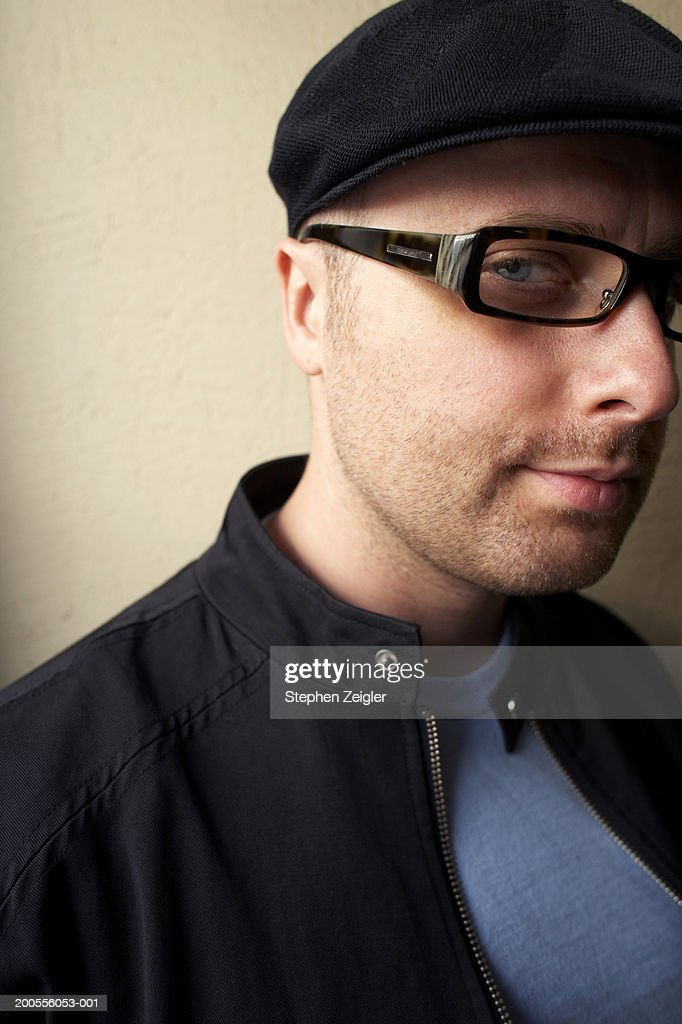 Portrait of mature man wearing cap and spectacles : Stock Photo