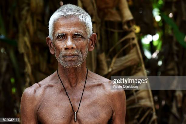 Portrait of mature shirt less Sri Lankan Man