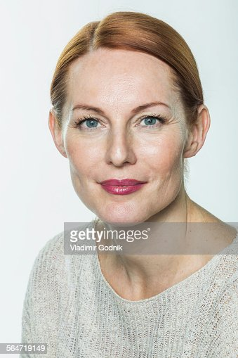 Portrait of mature woman against white background