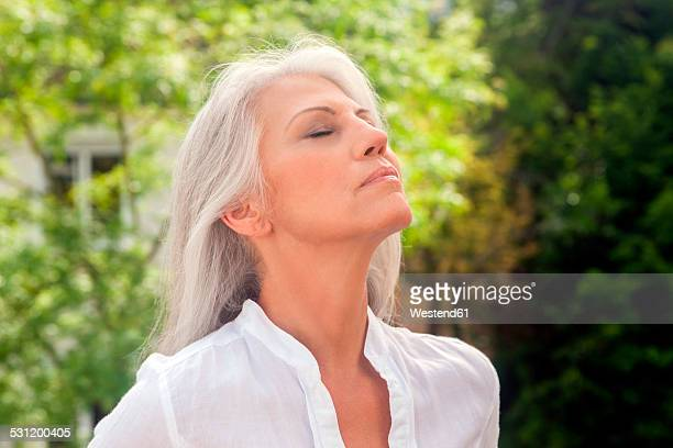 Portrait of mature woman enjoying fresh air
