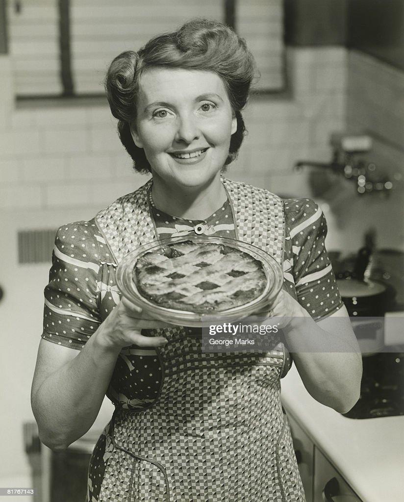 Portrait of mature woman holding pie : Stock Photo
