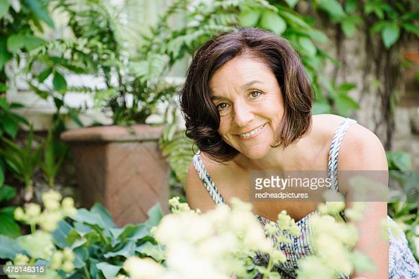 Portrait of mature woman in garden