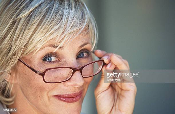 Portrait of mature woman looking over spectacles,close-up