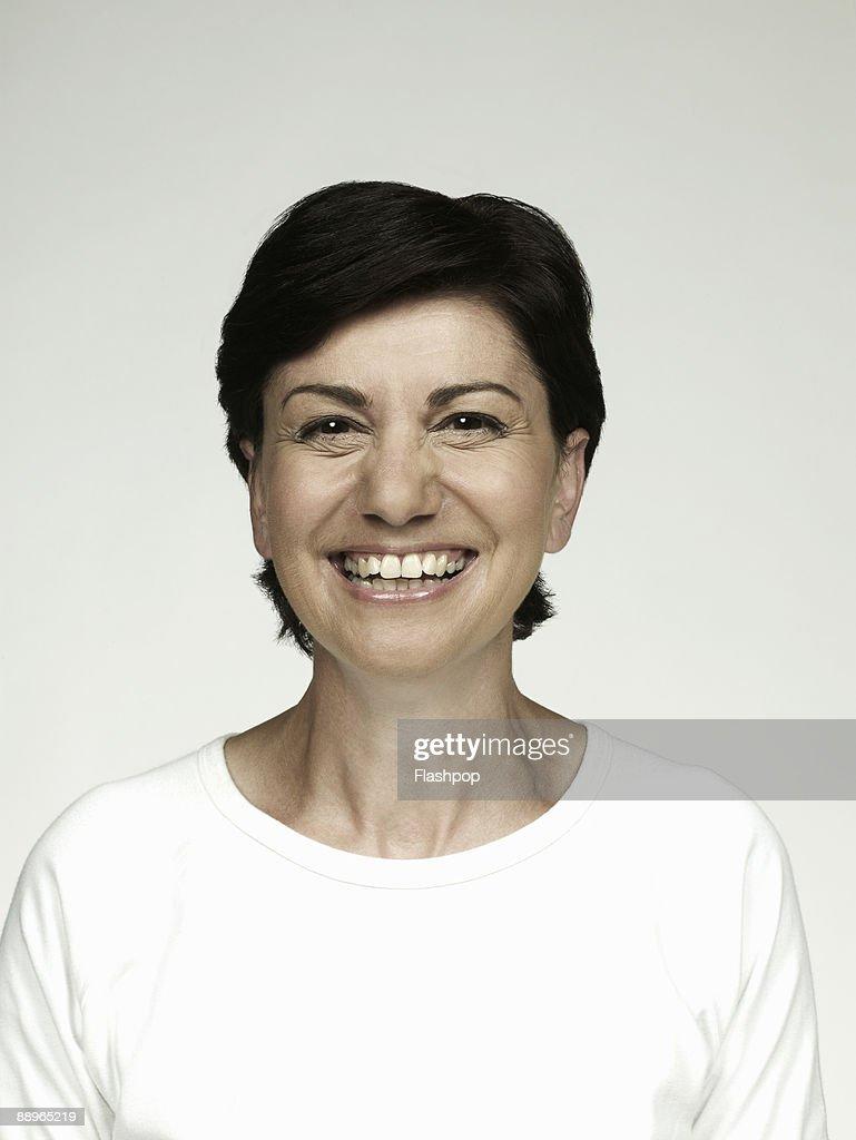 Portrait of mature woman smiling : Stock Photo