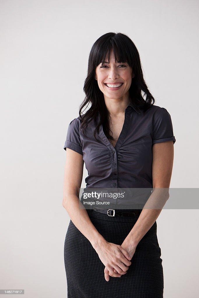 Portrait of mature woman smiling, studio shot