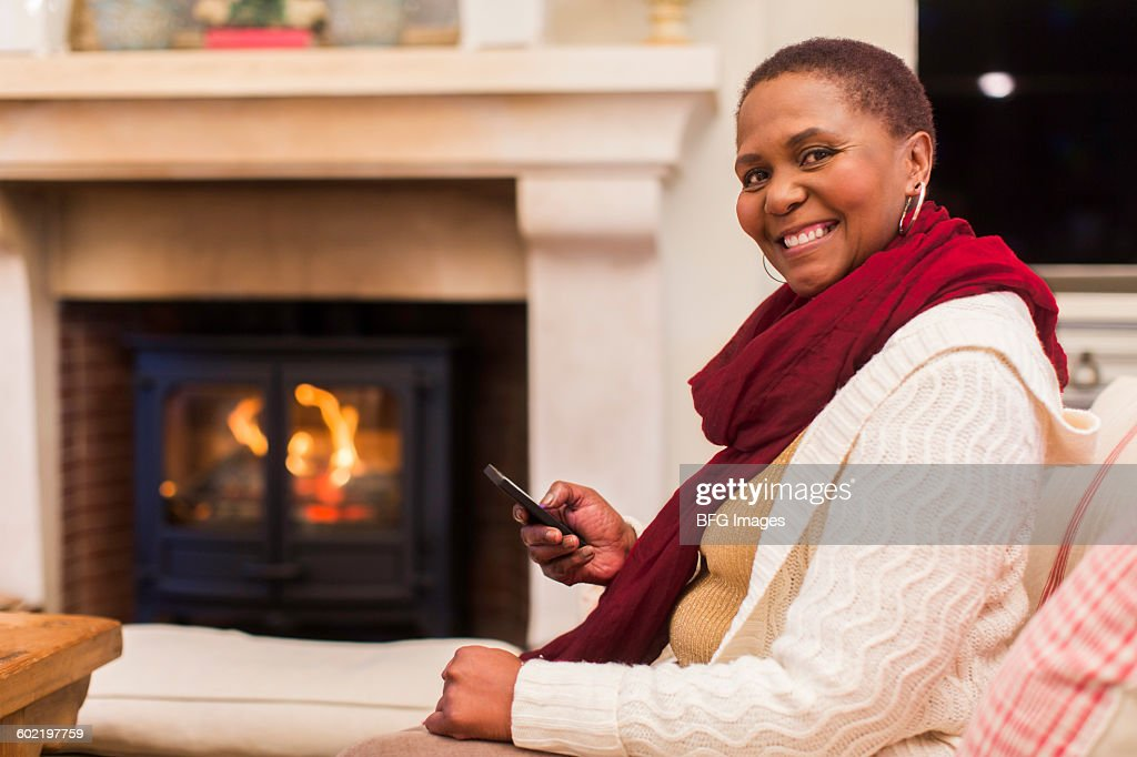 Portrait Of Mature Woman Texting In Living Room, Cape Town, South Africa :  Stock Part 62