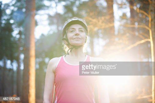 Portrait of mature woman wearing bicycle helmet : Stock Photo