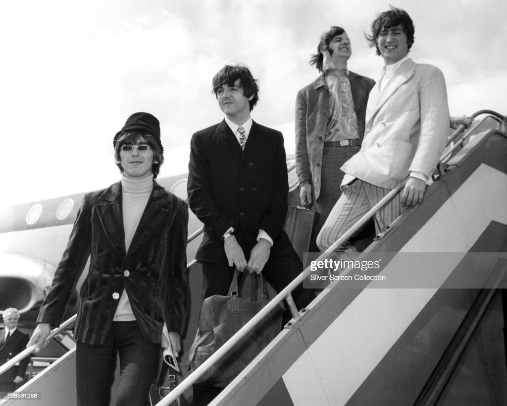 Portrait of members of the English Pop group the Beatles as they pose on an airstair at Heathrow airport, London, England, June 23, 1966. Pictured are, from left, George Harrison (1943 - 2001), Paul McCartney, Ringo Starr, and John Lennon (1940 - 1980).