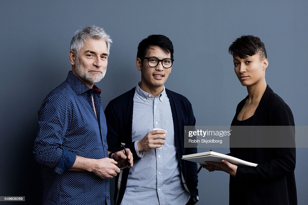 Portrait of men and woman with pen and paper