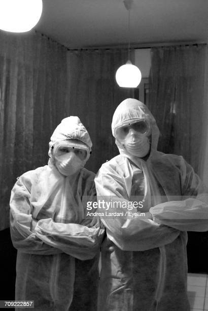 Portrait Of Men With Arms Crossed Wearing Protective Workwear