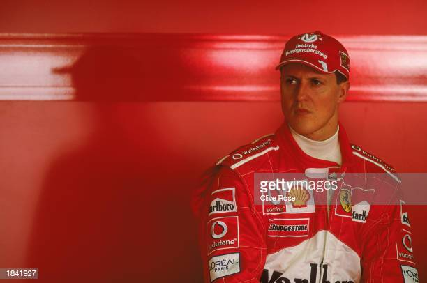 A portrait of Michael Schumacher of Germany and the Ferrari team in the garage before the Fosters Australian Formula One Grand Prix at Albert Park in...