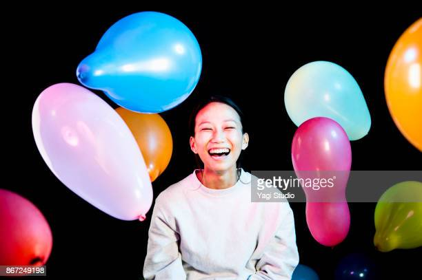 Portrait of mid adult japanese women with Colorful balloon