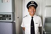 Portrait of mid adult male pilot smiling