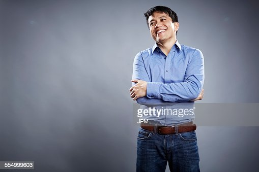 Portrait of mid adult man, arms crossed, smiling