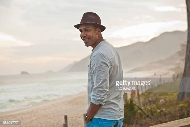 Portrait of mid adult man at beach, Rio De Janeiro, Brazil
