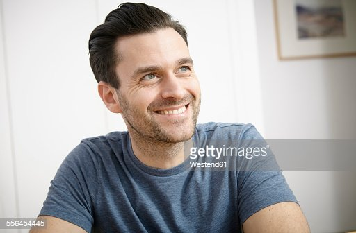 Portrait of mid adult man at home