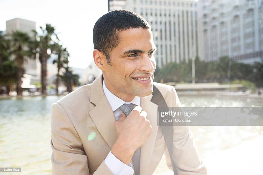 Portrait of mid adult man resting by fountain : Stock Photo