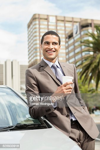 Portrait of mid adult man standing by car with coffee cup : Stock-Foto