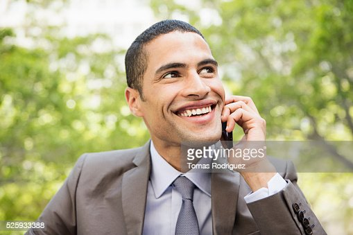 Portrait of mid adult man talking on phone : Bildbanksbilder