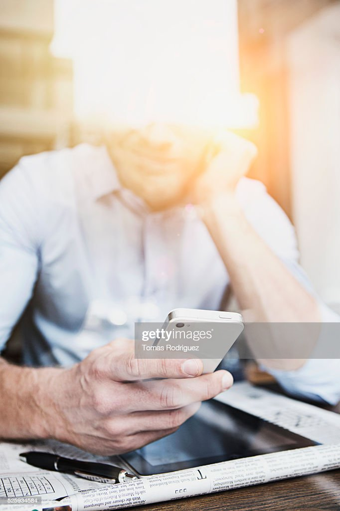 Portrait of mid adult man using cell phone : Stock Photo
