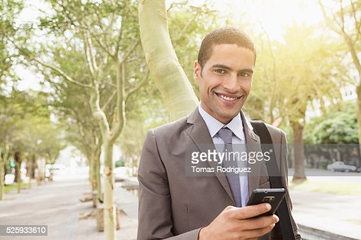 Portrait of mid adult man with cell phone : Stock Photo