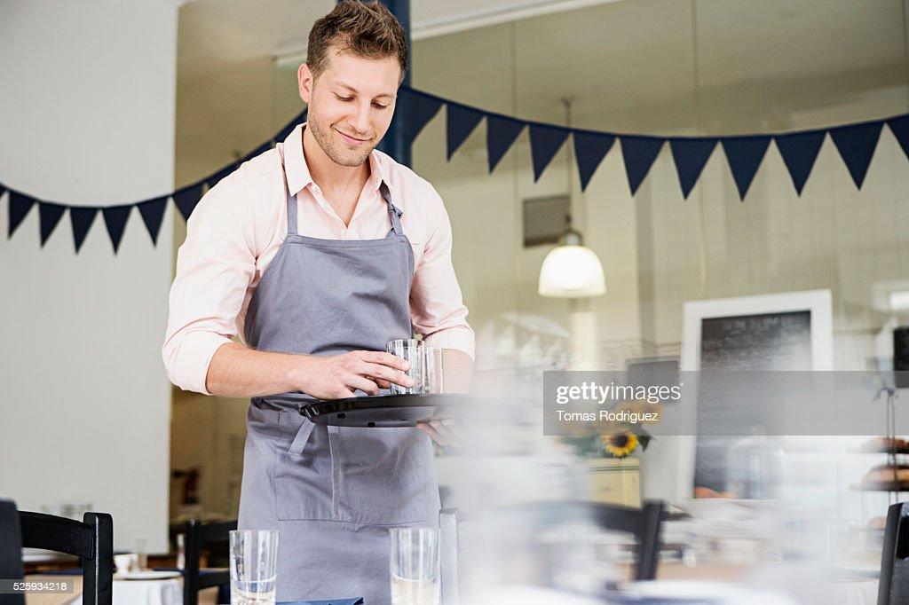 Portrait of mid adult waiter holding tray : Bildbanksbilder