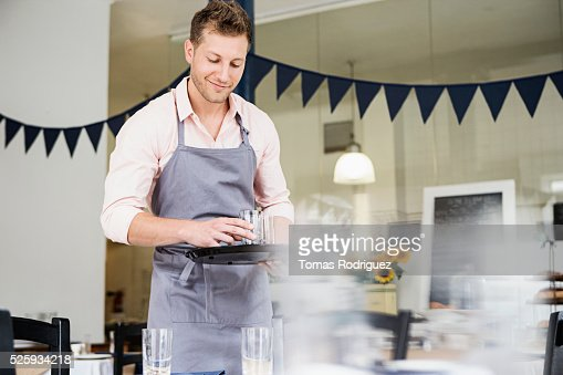 Portrait of mid adult waiter holding tray : Bildbanksbilder