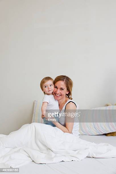Portrait of mid adult woman and her one year old baby girl