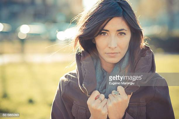 Portrait of mid adult woman holding collar in park