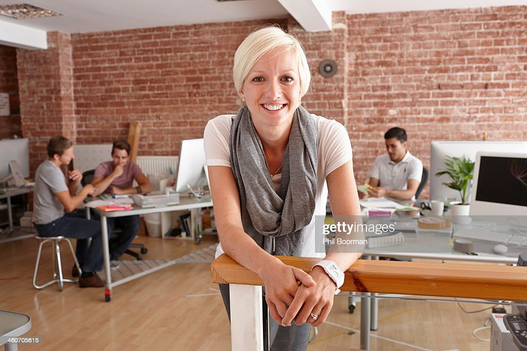 Portrait of mid adult woman in creative office