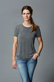Portrait of mid adult woman in grey t-shirt