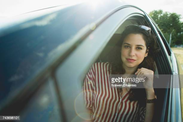 Portrait of mid adult woman sitting in car