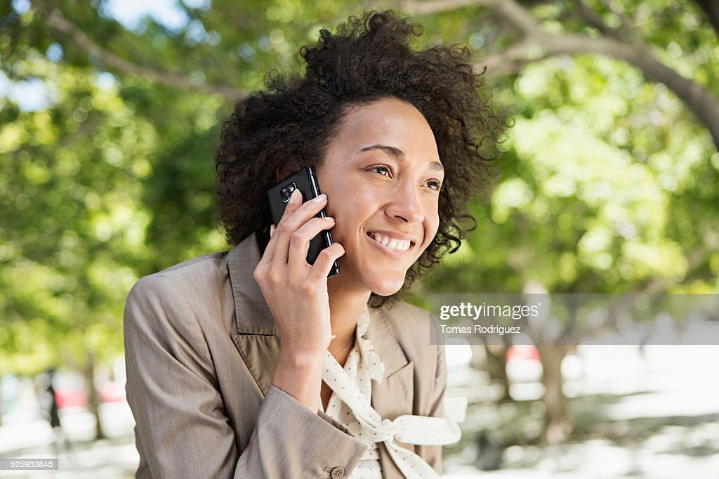 Portrait of mid adult woman talking on phone : Stock Photo