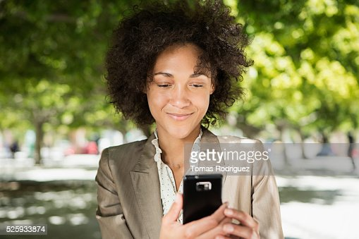 Portrait of mid adult woman using cell phone : Stock Photo